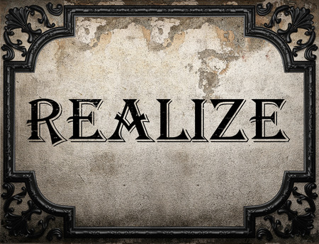 realize: realize word on concrette wall