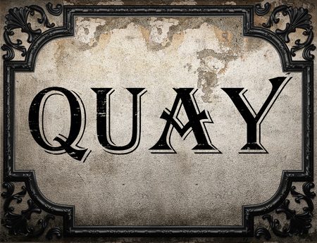 quay: quay word on concrette wall Stock Photo