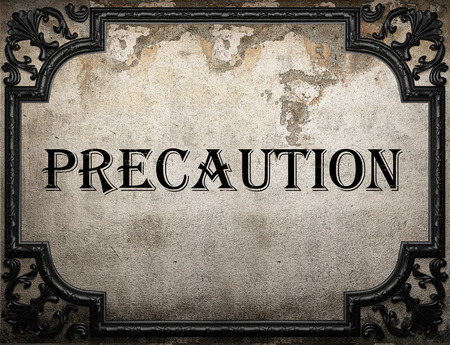 precaution: precaution word on concrette wall