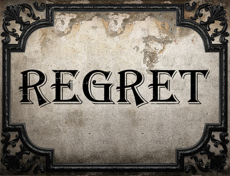 regret: regret word on concrette wall Stock Photo