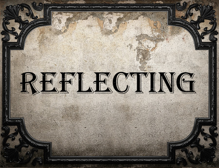 reflecting: reflecting word on concrette wall