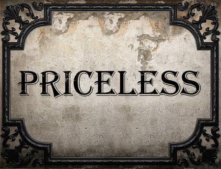 priceless: priceless word on concrette wall Stock Photo