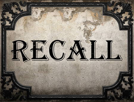 recall: recall word on concrette wall