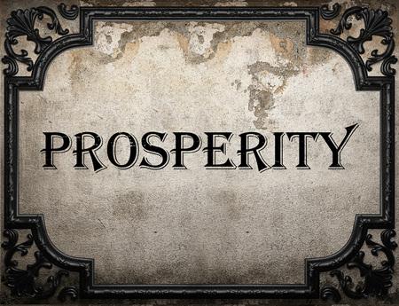prosperidad: palabra prosperidad en la pared concrette Foto de archivo