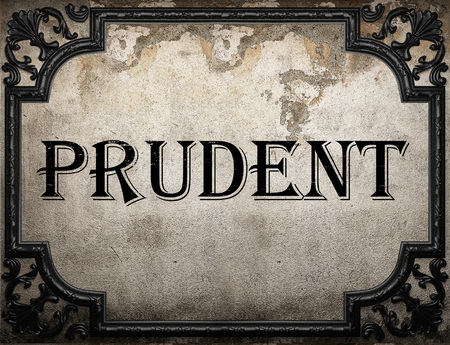 prudent: prudent word on concrette wall Stock Photo