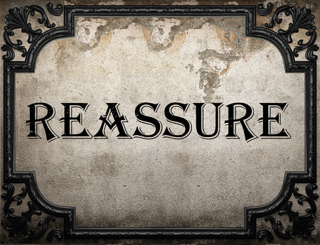 to reassure: reassure word on concrette wall