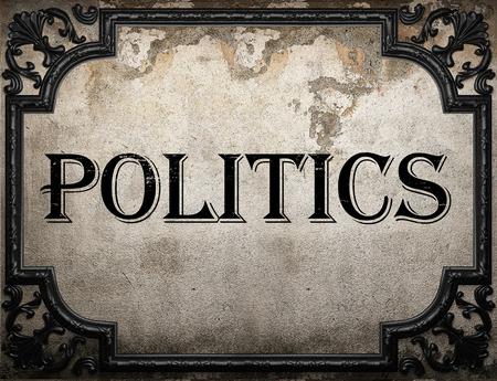 politics word on concrette wall Stock Photo