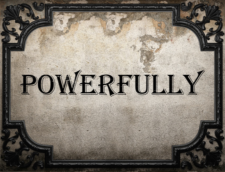 powerfully: powerfully word on concrette wall Stock Photo