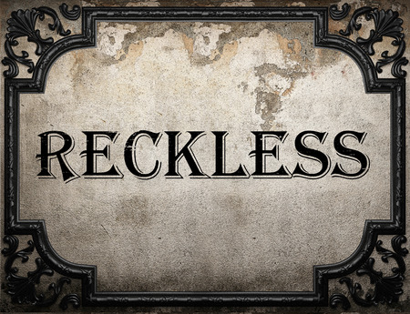 reckless: reckless word on concrette wall Stock Photo