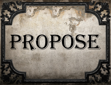 propose: propose word on concrette wall Stock Photo