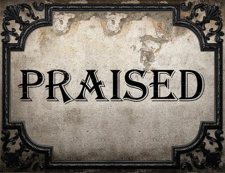 praised: praised word on concrette wall