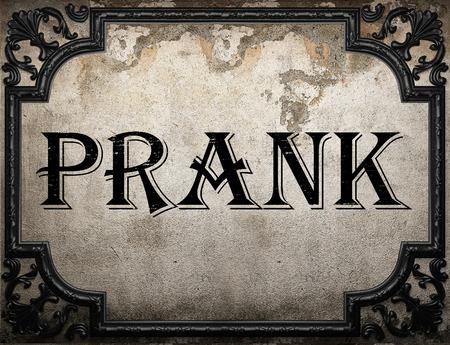 prank: prank word on concrette wall