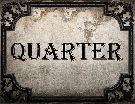 quarter: quarter word on concrette wall Stock Photo