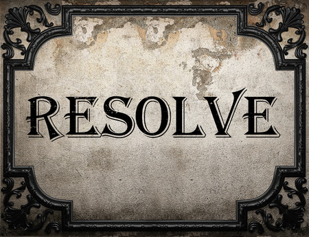 resolve: resolve word on concrette wall