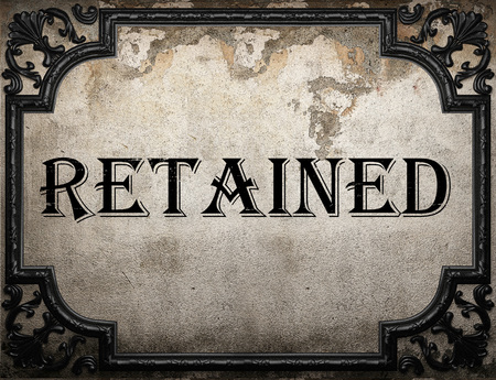 retained: retained word on concrette wall