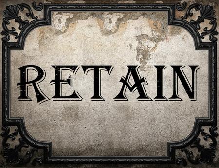 retain: retain word on concrette wall Stock Photo