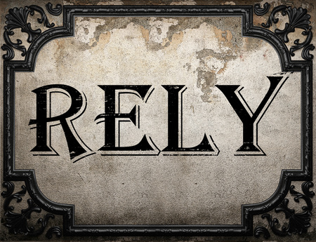 rely: rely word on concrette wall Stock Photo