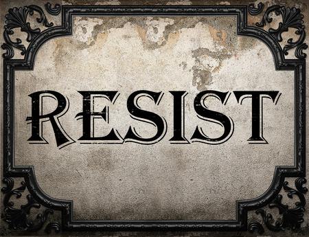resist: resist word on concrette wall