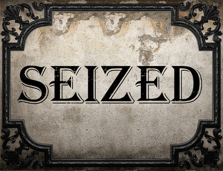 seized: seized word on concrette wall