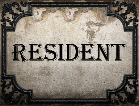 resident: resident word on concrette wall