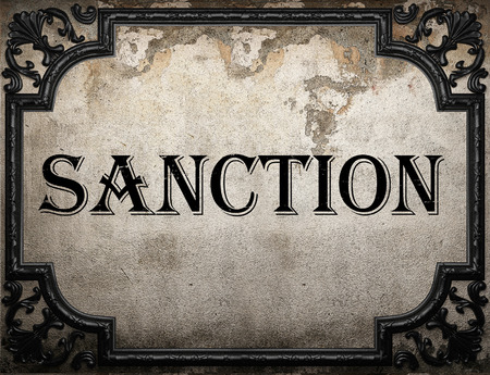 sanction: sanction word on concrette wall Stock Photo