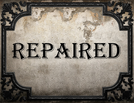 repaired: repaired word on concrette wall