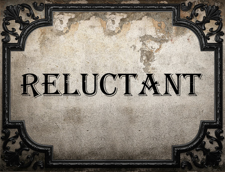 reluctant: reluctant word on concrette wall