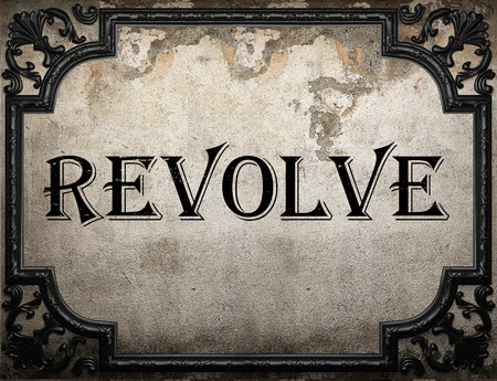 revolve: revolve word on concrette wall Stock Photo