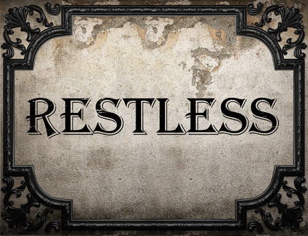 restless: restless word on concrette wall Stock Photo