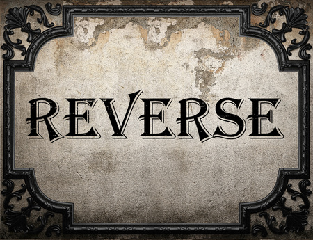 reverse: reverse word on concrette wall
