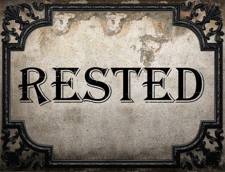 rested: rested word on concrette wall Stock Photo