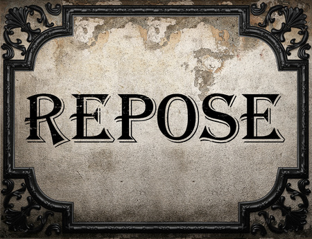 repose: repose word on concrette wall Stock Photo