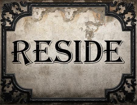 reside: reside word on concrette wall