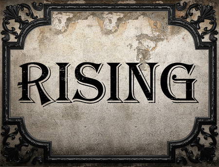 rising: rising word on concrette wall