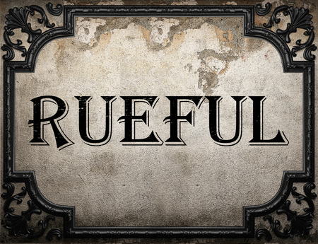 rueful: rueful word on concrette wall