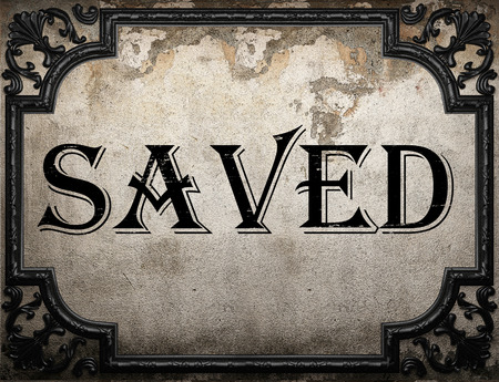 saved: saved word on concrette wall