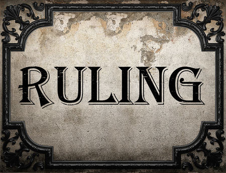 ruling: ruling word on concrette wall