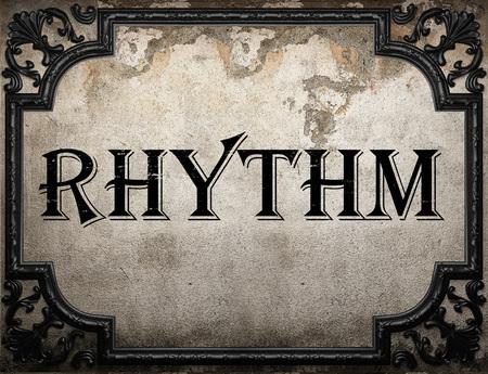 rhythm word on concrette wall Stock Photo