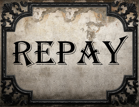 repay: repay word on concrette wall Stock Photo