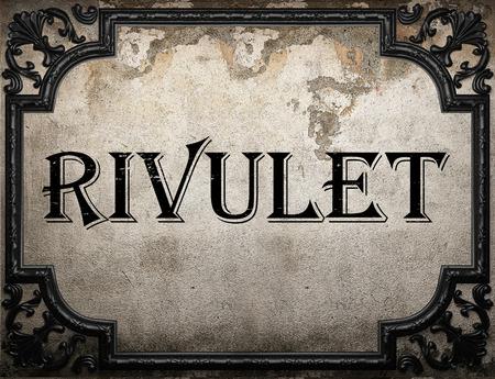 rivulet: rivulet word on concrette wall Stock Photo