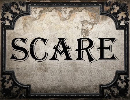 scare: scare word on concrette wall