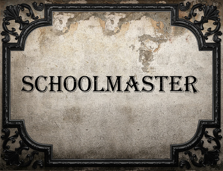schoolmaster: schoolmaster word on concrette wall