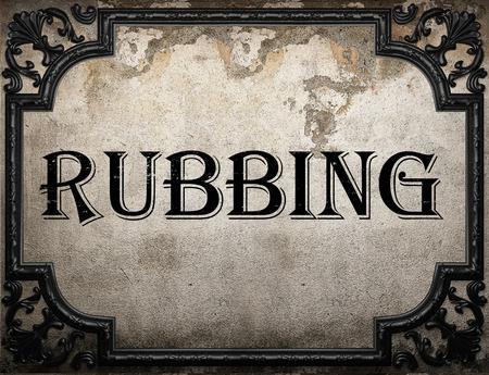 rubbing: rubbing word on concrette wall Stock Photo