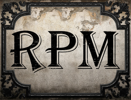 rpm: rpm word on concrette wall Stock Photo