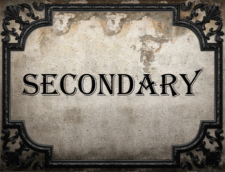secondary: secondary word on concrette wall Stock Photo