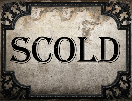 scold: scold word on concrette wall Stock Photo