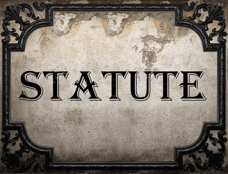 statute: statute word on concrette wall