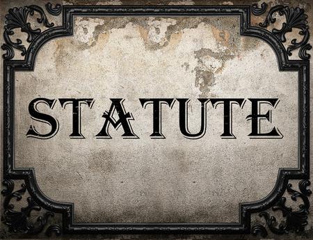 statute: statute word on concrette wall