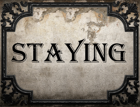 staying: staying word on concrette wall