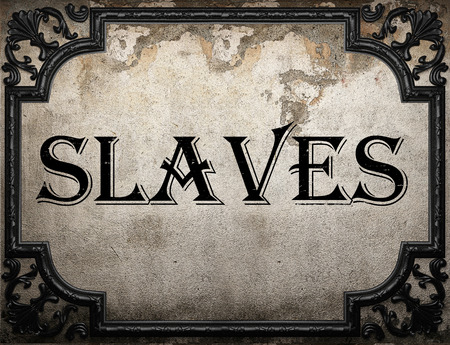 slaves: slaves word on concrette wall